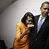 Michelle goofs off while keeping close to Barack.