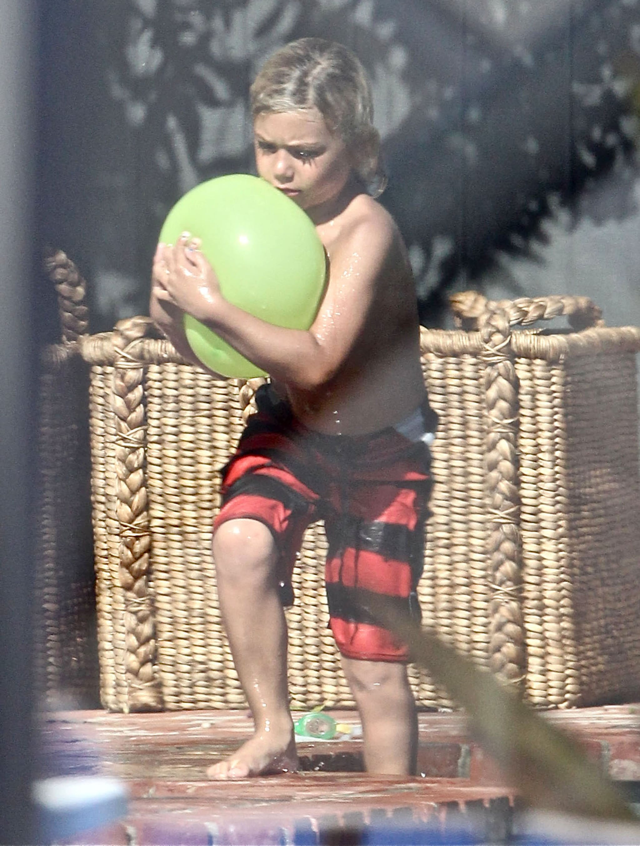 Kingston Rossdale had fun with water balloons at a Memorial Day party at Joel Silver's house in LA.