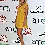 Nicole Richie posed in a flirty yellow dress.