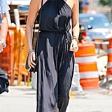 Looking for some style inspiration for your next brunch with the girls? We love how Olivia Munn's black maxi, floppy hat, and shoulder bag look elegant but easy.