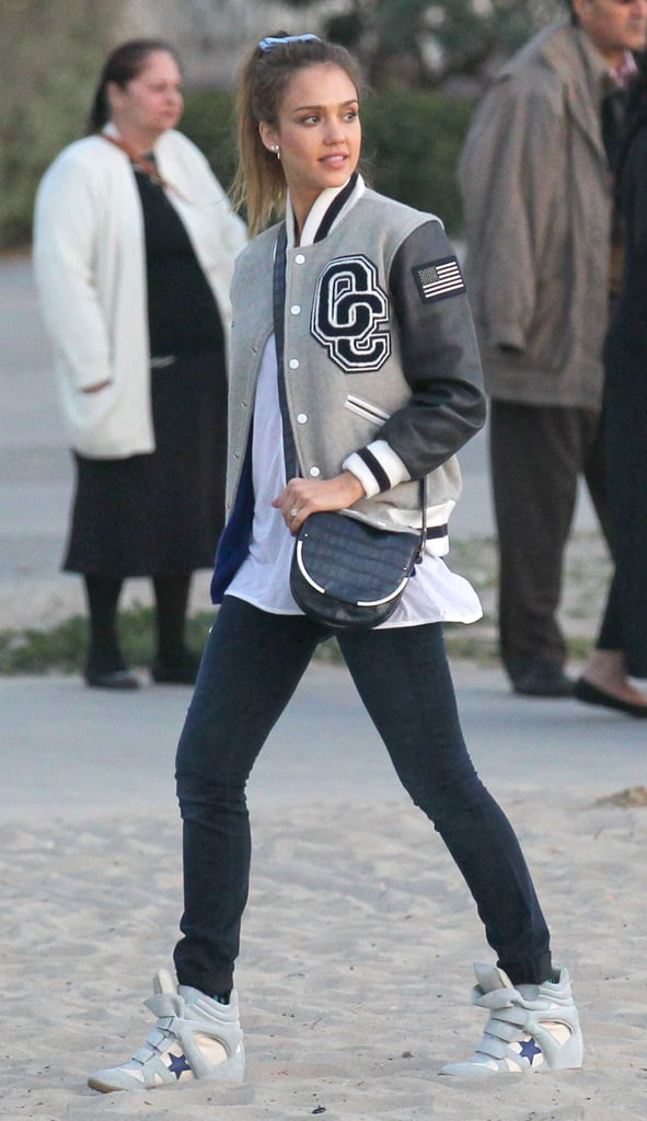 While at a Santa Monica park with her family, Jessica mixed sporty with chic in an Opening Ceremony varsity jacket, wedged Isabel Marant sneakers, and a navy Vince Camuto crossbody bag.
