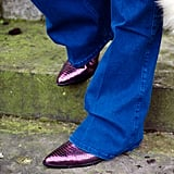 Don't forget the footwear – this seventies styling isn't over yet. Invest in a pair of snakeskin style boots or shoes in a key pointed shape and metallic finish and you'll look sharper than a Saville Row suit.
