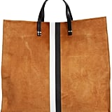 Stash everything you need covertly in this Clare Vivier Simple Stripe Suede Tote ($495).