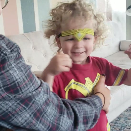 Video of Little Boy Putting on Wonder Woman Costume