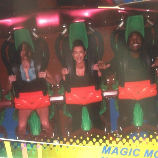 Kim Kardashian looked terrified riding a roller coaster with boyfriend Kanye West.  Source: Instagram user kimkardashian