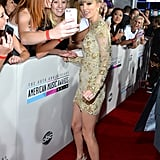 Taylor Swift flashed a smile on the red carpet.