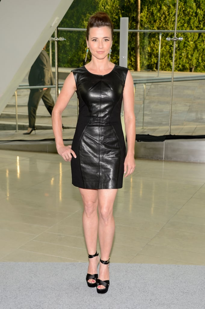 Linda Cardellini was slick in a little black leather minidress and matching ankle-strap sandals.