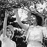 Elizabeth and Margaret played with their pet chameleon on the grounds of Windsor Castle in 1941.
