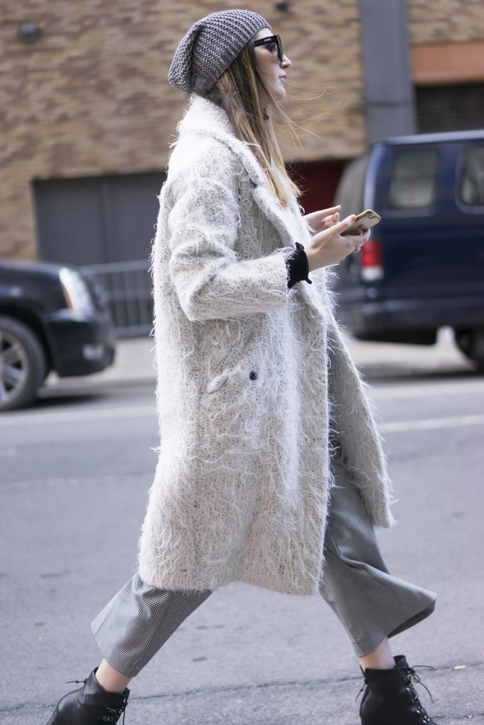 With a Shaggy Jacket, a Beanie, and Black Booties