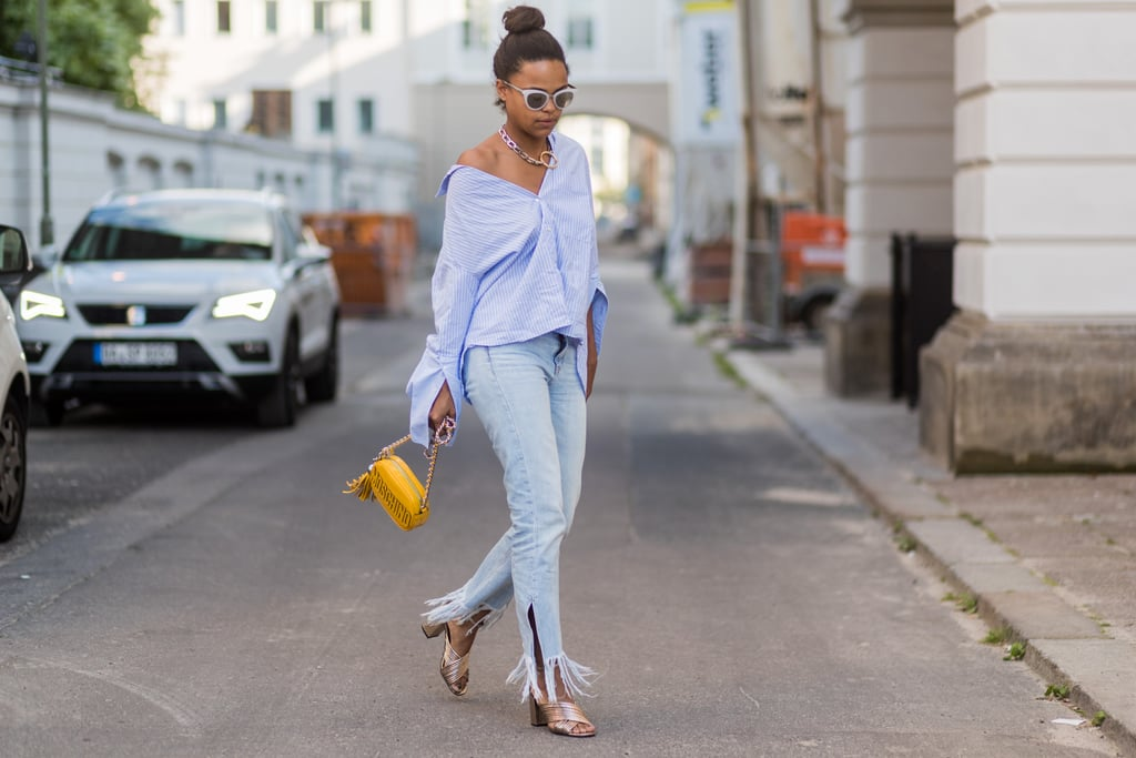 With a nonchalant top to counter frayed denim