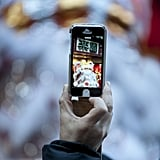 A man snapped a picture during the lion dance performance in Yokohama, Japan.