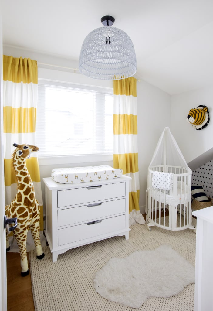 """""""Before I had Leo, I wanted his nursery to be white, gray, and neutral — including his toys. Now that I'm watching him grow and develop, I understand the importance of decorating with color. That's why I wanted to add pops of brightness to the Vancouver nursery for him, and I absolutely love the way it turned out!"""" Jillian explains."""
