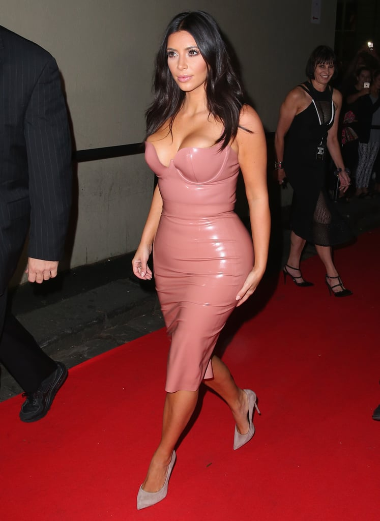 "Kim Kardashian's curves are the centre of attention, even when she's fully clothed. The reality star travelled Down Under on Tuesday to promote the Australian launch of her new fragrance, Fleur Fatale. She slipped into a pink latex ensemble by Atsuko Kudo, the same designer who created the latex bodysuit that she wore to the GQ Men of the Year Awards in London back in September. While Kim was in Oz to promote her new perfume, everyone was still talking about her Internet-breaking photo shoot for Paper magazine. She even taught Rove McManus how to balance a champagne glass on his butt like she did for the now-infamous spread. When asked about the project, Kim said that she thought of it as ""an art project"" since the photographer, Jean-Paul Goude, is a world-renowned artist. She added, ""I just hope people like the pictures."""