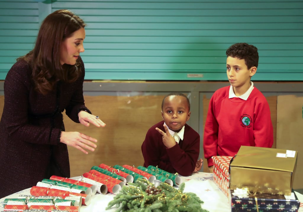 "Kate Middleton paid a special visit to the Rugby Portobello Trust in London on Tuesday to pass out Christmas gifts to families and children, and one little boy seemed more than ready for his close-up with the duchess. While Kate knelt down for a chat, 7-year-old Yahya Hussein Ali flashed a peace sign for the cameras, a move that Kate appeared to react to with ""OK, calm down, cool guy."" Technically, she should have some familiarity with being upstaged by a small child, as she nearly was while trying to wrangle a rogue pageboy at her sister Pippa's wedding back in May.   Yahya was one of many children who were affected by the Grenfell Tower fire in June, and both Kate and her husband, Prince William, have been doing their part to meet with families who were displaced after the tragic event. It's just the latest adorable moment we've seen of Kate interacting with kids over the years."