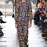 With its rich fabric and vintage-inspired bishop sleeves, we immediately picked this gown for Kate upon seeing Tory Burch's new collection.
