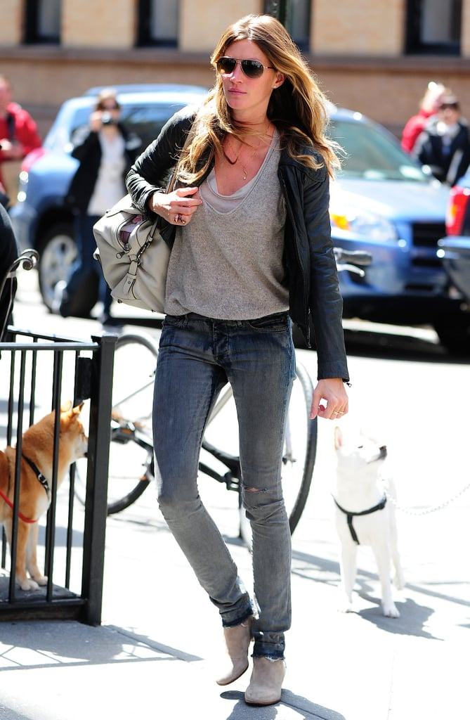 Gisele Bündchen kept it casual (and cool) when she sported ripped skinny jeans with grey booties, a black leather jacket, and aviator sunglasses in NYC.
