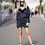Give your denim mini a sporty feel with a color-block top and futuristic sneakers.