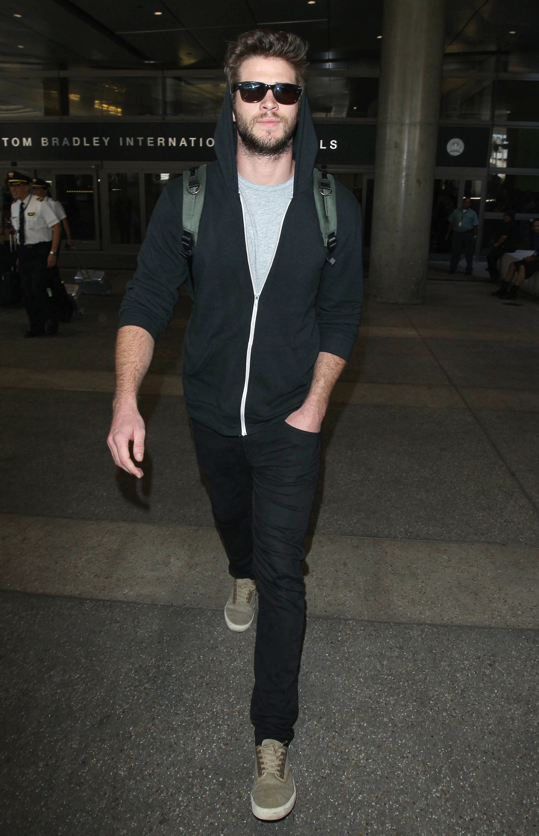 Liam Hemsworth touched down at LAX on Friday.