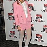 Pastel pink was also an early favourite for Suki, when she teamed a shorts suit with white boots for a full-on '60s look back in February 2012.