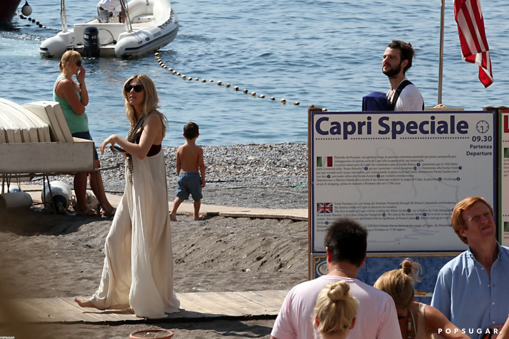 Sienna Miller walked along the beach in Positano.
