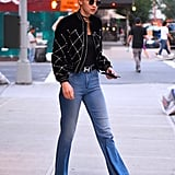 Gigi Chose to Wear Flares and a Black Bomber That Matched Her Shirt