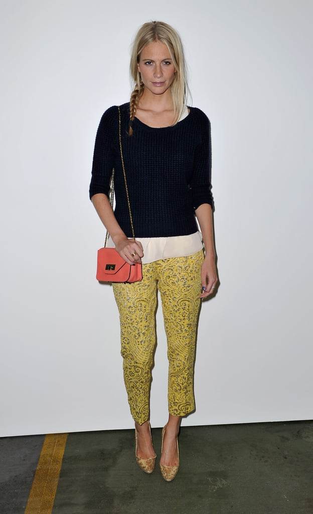 Poppy Delevingne wore a Paul Smith sweater over a Rag & Bone top, sparkly Dolce & Gabbana trousers, gold Manolo Blahnik heels and a bright Chloe bag.