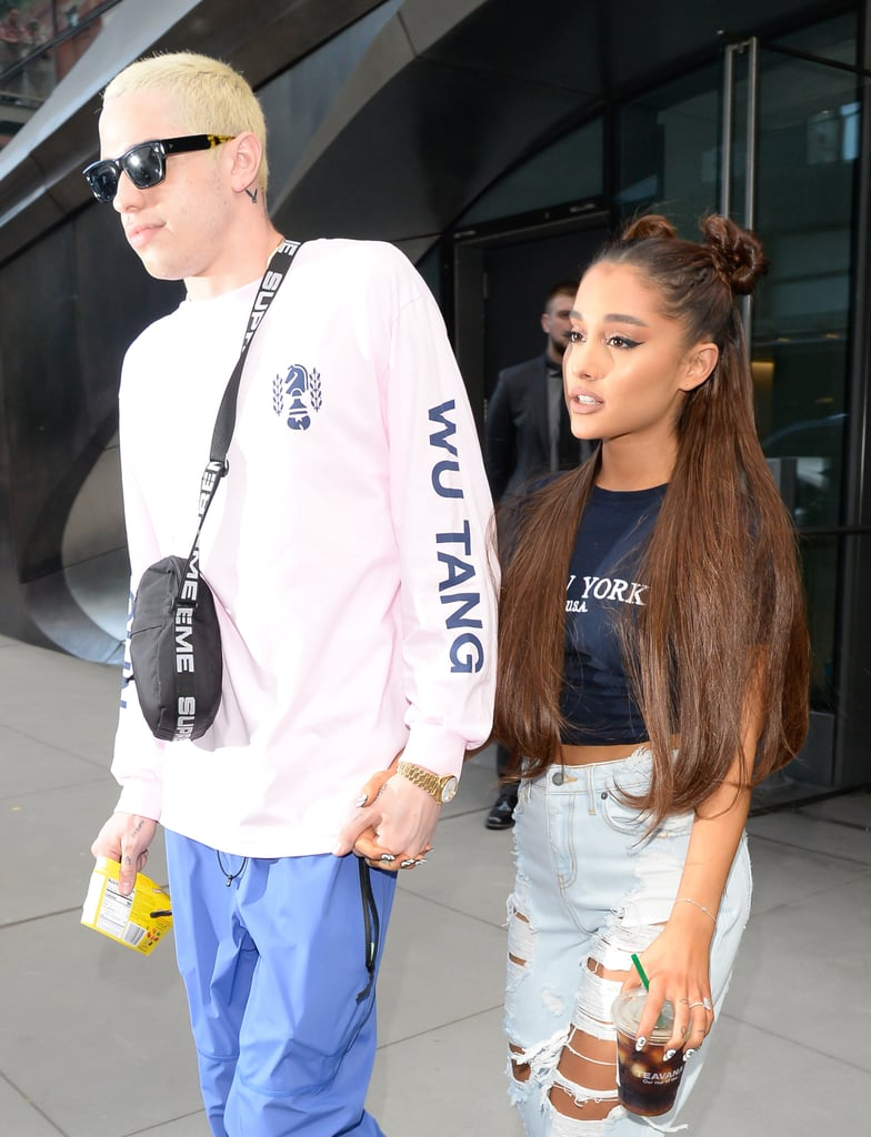 Ariana Grande and Pete Davidson have enjoyed a fast and furious relationship since they began dating in May. In addition to sharing several tattoos, the high-profile couple also seem to be converging their styles with trendy streetwear and even matching mouth masks. Recently, the 24-year-old comedian dyed his hair platinum blond in a decision that may have been inspired by his pop star fiancée, if you're into that sort of romantic thing. Though the 25-year-old singer is currently wearing her signature brown shade, Grande has also experimented with platinum hair in the past, as well as gray hair. On her latest Elle cover for the magazine's August issue, Grande was again photographed with long blond hair. Given how rapidly and passionately the relationship has progressed, it's not entirely out of the question that Grande has also influenced Davidson's latest hair transformation, of all things. The things you do for love, right?