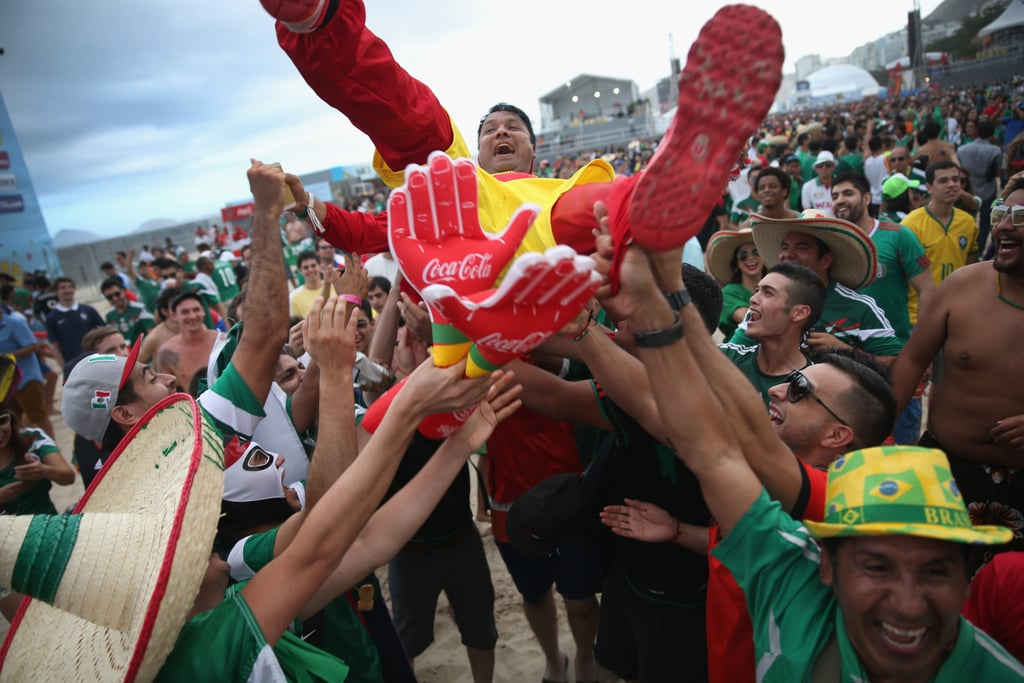 A Mexico fan crowd-surfed on Copacabana Beach in Brazil.