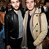 Douglas Booth and Sam Claflin stuck together at the Mulberry fashion show in February 2013.