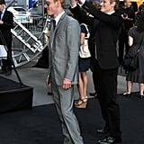 Lucas Till did double rabbit ears on Michael Fassbender at the May 2011 premiere of X-Men: First Class in NYC.