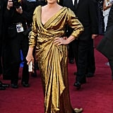 Meryl wore a custom draped gold lamé draped Lanvin gown to the 2012 Oscars.