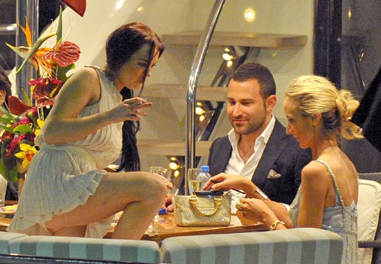 Lindsay Lohan spends an evening out on a yacht with friends, drinking and smoking in Cannes