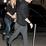 Justin Theroux held Jennifer Aniston's hand as they walked around Paris together in June.