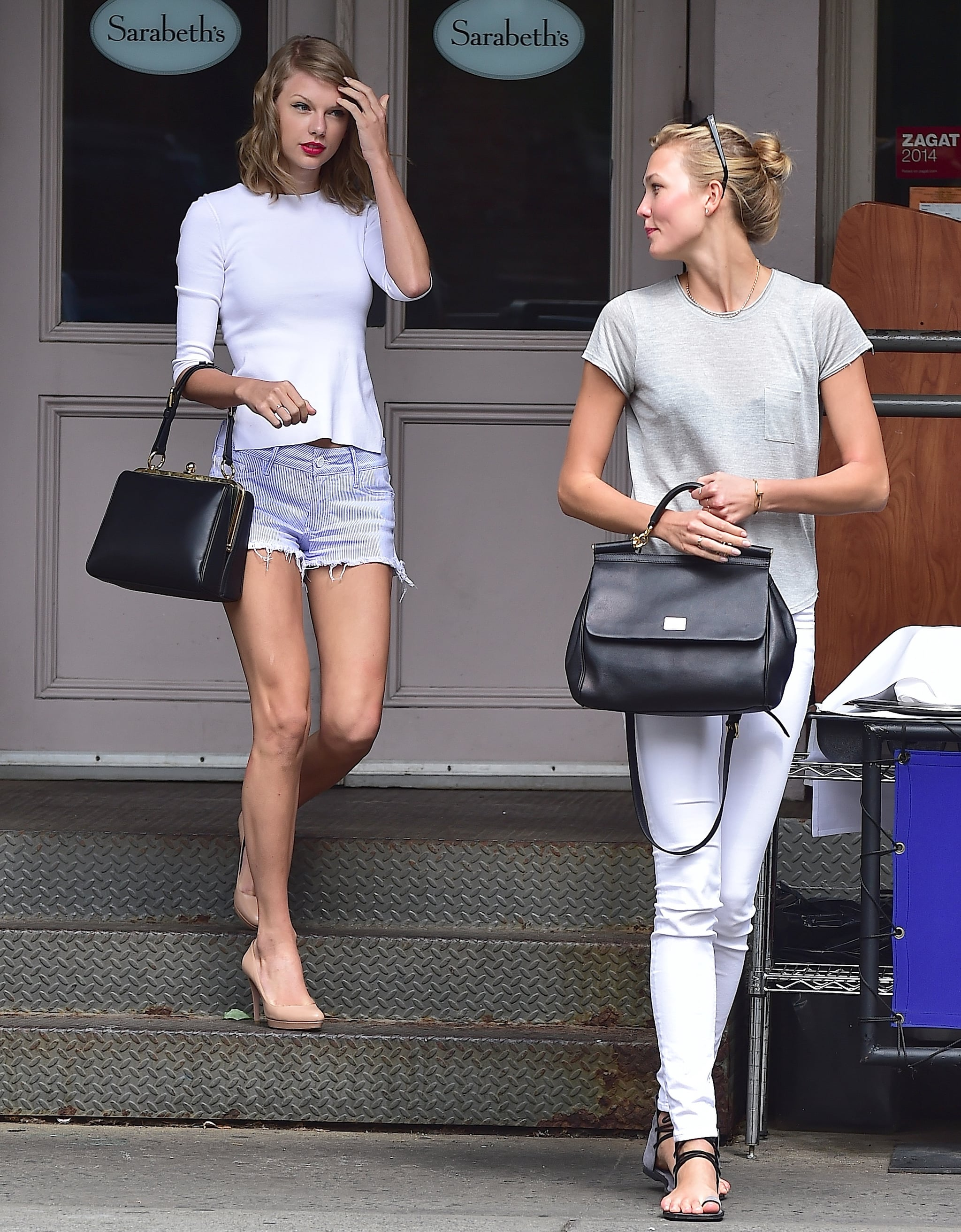It's not like we haven't seen Taylor and Karlie together before, but we're fawning over this particular sighting because, well, they're both carrying Dolce & Gabbana satchels — the Agata and the Sicily, respectively. Not only do each of the bags complement the girls' outfits, but they also jibe with Karlie's and Taylor's distinctive tastes. So decide which way you'd go — classic and sharp like Taylor or laid-back with a boho touch like Karlie — then scroll down to see how you can pull off both looks. Here's to all the fashion friends out there. Source: Getty / Alo Ceballos