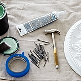 """Here's What You'll Need  1 quart semigloss paint (I used Benjamin Moore, Spruce Green) Finish nails (I used 2"""") Paintable caulk Hammer Painter's tape  Faux-plaster ceiling medallion (mine are 14"""" in diameter)  Dummy doorknob (one per medallion)"""