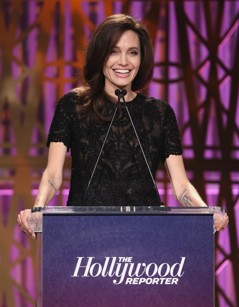"Angelina Jolie was one of the esteemed guests at The Hollywood Reporter's annual Women in Entertainment Breakfast in LA on Wednesday. The actress and First They Killed My Father director skipped the red carpet, but took the stage inside to deliver a keynote speech, during which she spoke candidly about female solidarity through art.  ""We have a level of freedom that is unimaginable for millions of other women around the world — women who live with conflict and terrorism and displacement and poverty, who never get a chance, whose voices are always silenced,"" she told the crowd, which included other badass women like Shonda Rhimes, Glenn Close, Gal Gadot, and Jennifer Lawrence, who was honoured with the Sherry Lansing Leadership during the ceremony. ""I pay tribute to the women artists, journalists, human rights defenders, and lawyers around the world who refuse to be intimidated; the brave people who are fighting so that others may one day have the freedoms we now have,"" Angelina added.  Backstage, Angelina signed autographs and posed for selfies with a group of girls from THR's Women in Entertainment Mentorship Program, who were presented with more than $1 million in scholarships by Justin Timberlake and Gal Gadot. Keep reading for all the best pictures from Angelina's outing."