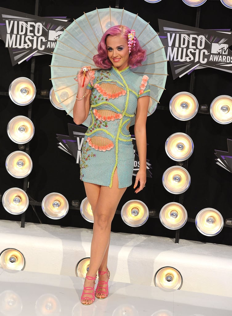 The pink-locked princess was all smiles in a beaded, cutout kimono minidress, candy-pink heels, and a sweet parasol at the 2011 MTV Video Music Awards.