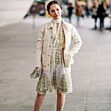 Pair your sandals with a printed dress and white jacket.