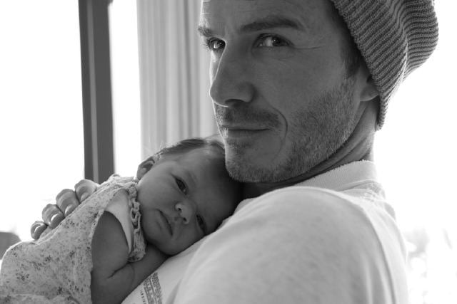 Victoria Beckham snapped a father-daughter photo of David and Harper that she shared with fans in August 2011.