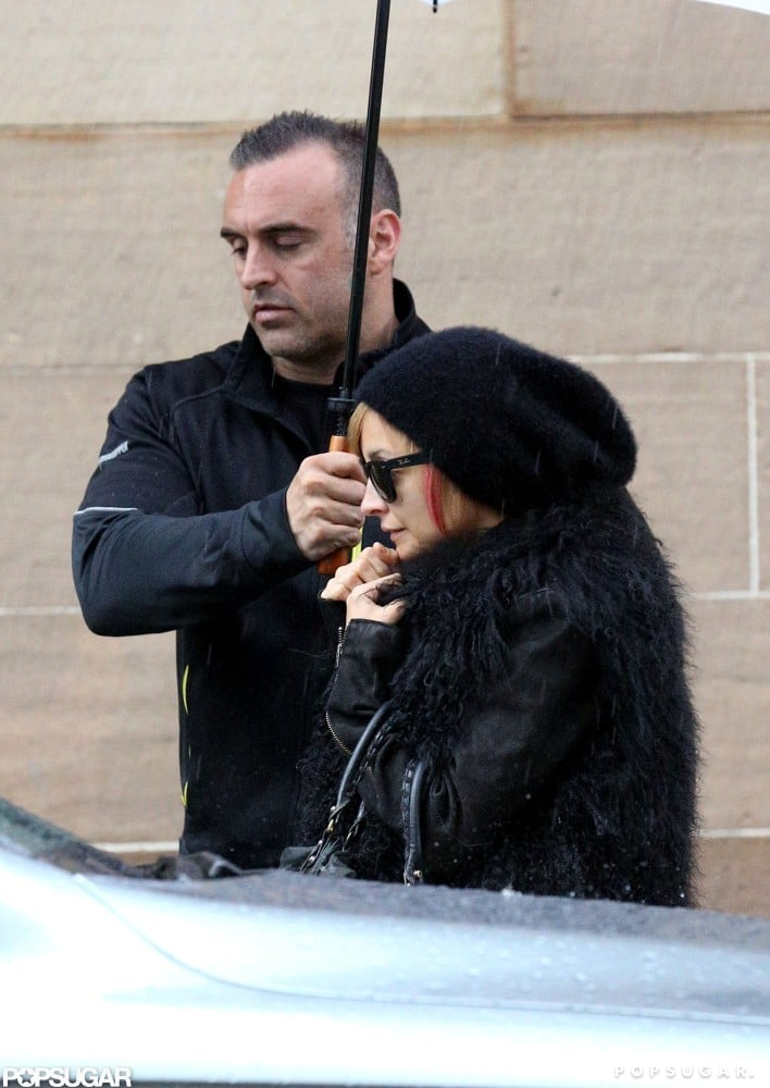 Nicole Richie wore a black hat to cover her hair from the rain in Australia.