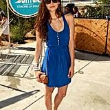Nina Dobrev sported a breezy blue racerback at Burton's pool party.
