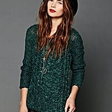 Pair Free People's emerald-green chunky cable pullover ($70, originally $148) with dark red trousers for a superchic take on holiday dressing.