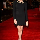 For the UK premiere of The Hunger Games, Meghan wore a long-sleeved black dress with an embellished neckline.