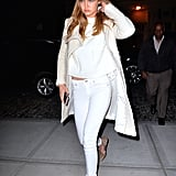 Wearing white Rag & Bone skinny jeans with a white shirt, coat, and hat, completing the look with leopard flats.
