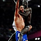 Silver medalist Mahiedine Mekhissi-Benabbad of France held gold medalist Ezekiel Kemboi of Kenya after their race.