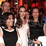 Angelina Jolie posed at an after party with fans.
