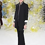 At Michael Kors, Olivia went sleek in all black, pairing flares with a varsity jacket and layering a black blazer on top.