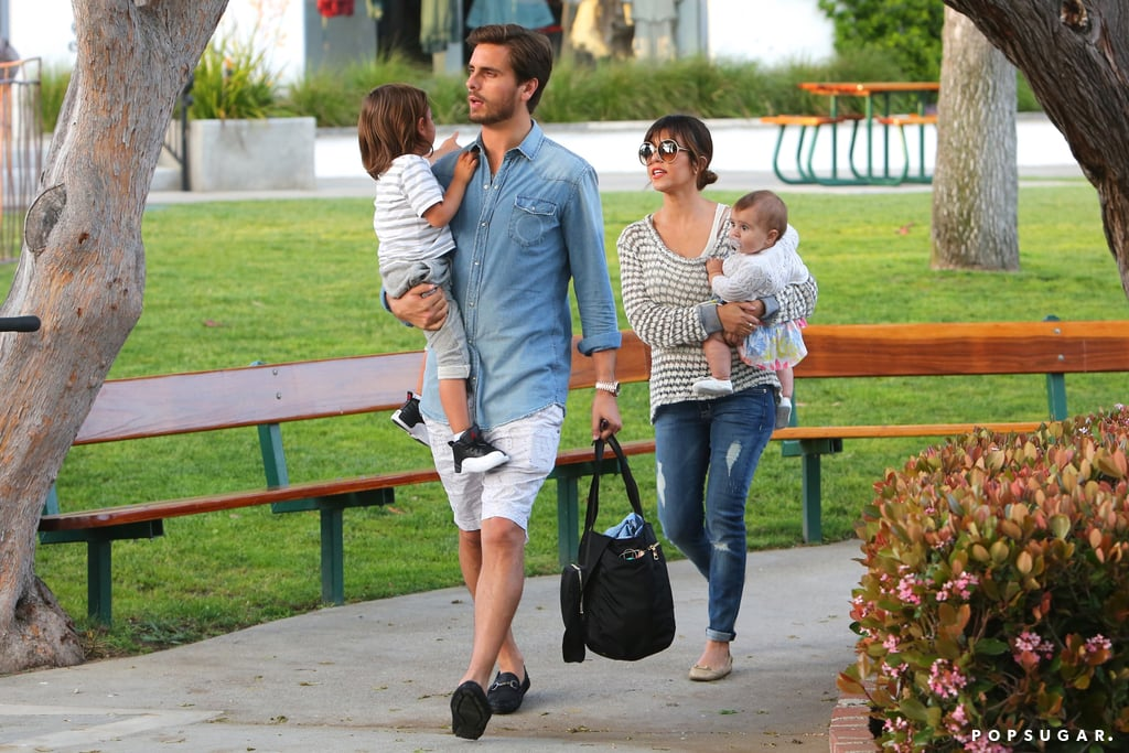 Kourtney Kardashian and Scott Disick carried their little ones, Mason and Penelope, to a park in Malibu on Saturday.