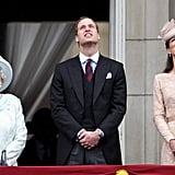 The queen watch an RAF flypast with the Duke and Duchess of Cambridge.