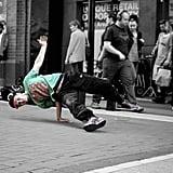 Tip a street performer.